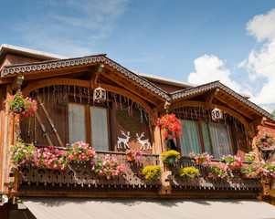 French Alpine wooden house decorated with flowers