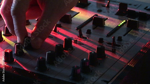Close up of a DJ using his turntables and mixer during a party