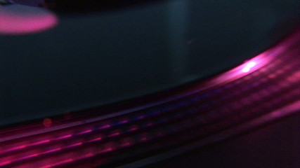 Close up of a disc on a dj's mixer during an event