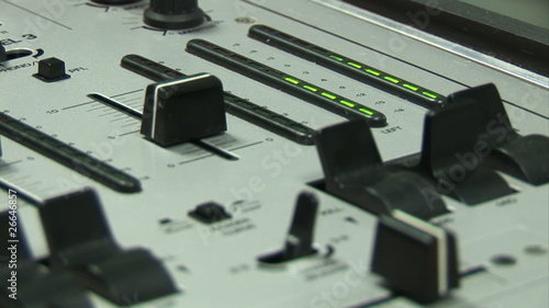 Close up of a sound engineer recording a song in studio