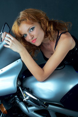 Sexy girl model with a motobike