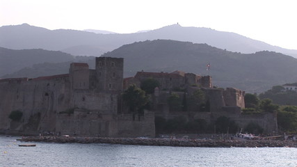 Front view of a castle lining the sea