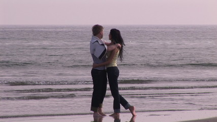 Lovely couple kissing on the beach
