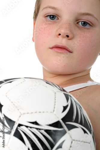 Small boy holding the football ball isolated on white