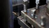 Metalworking lathe, metal shavings in factory poster