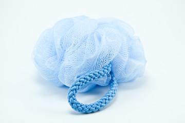 Blue round bath sponge isolated on white