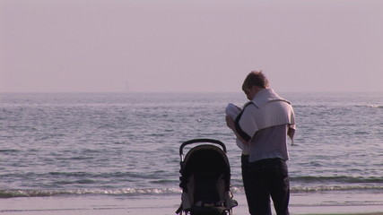 Young couple with their baby on the beach