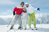 Sporty family on winter vacation poster