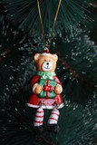 Bear holding a gift box (Christmas ornament)