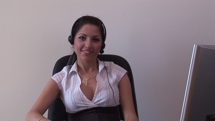 Seductive secretary on phone with earpiece in the office