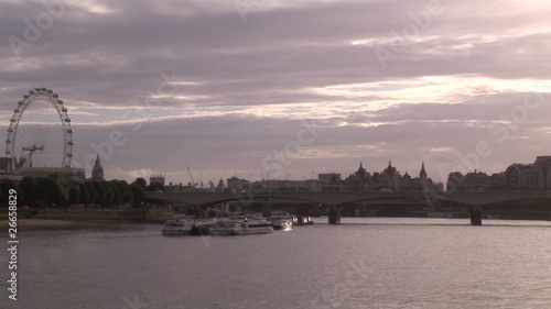 View of the Thames with London eye on background dring sunrise