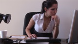 Pretty woman writing on keypad in her office