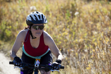 Determined woman mountain biking