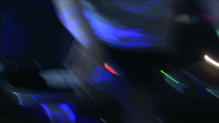 Close up of a dj at work in a discotheque