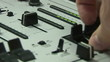 Close up of a sound engineer using his crossfader