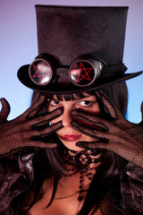 Portrait of gothic girl wearing tophat