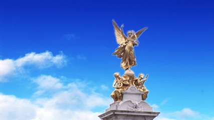 Front view of an angel statues with blue sky in slow motion