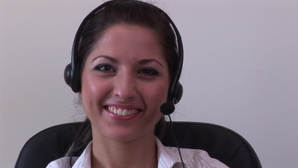 Portrait of a businesswoman with earpiece on