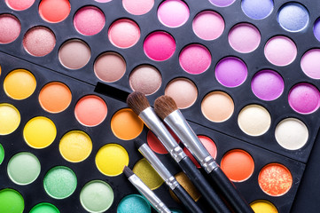 Professional Makeup set over white.Bright colors