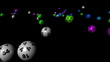 3d animation of multicoloured balls rolling in a black space