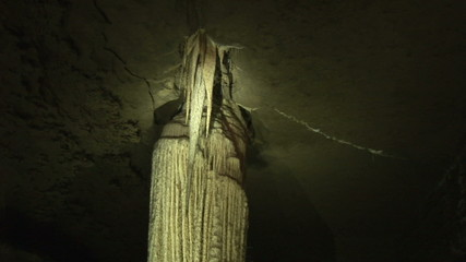 Close up of a stalactite lighting up in a cave