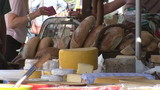 Close up of a cheese display in a market