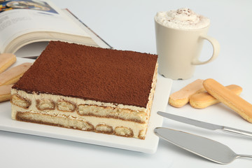 square cake with coffee and biscuits