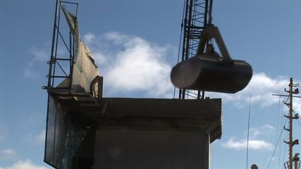 Crane uploading merchandise in a port