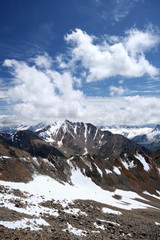Rocks, snow, clouds and sky in Caucasus mountains