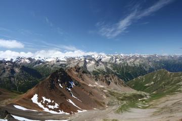 Mountain rocky ridge against blue sky in Caucasus mountains