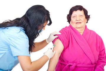 Nurse vaccine elderly woman patient