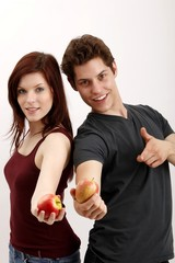 young couple with apples