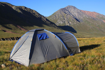 Tourist tent in a mountain landscape