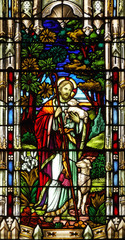 Nineteenth century church stained glass window Jesus shepherd