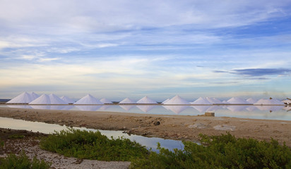 Salt mountains reflecting in the salt lake at Bonaire