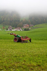 tractor standing next to the mowed grass