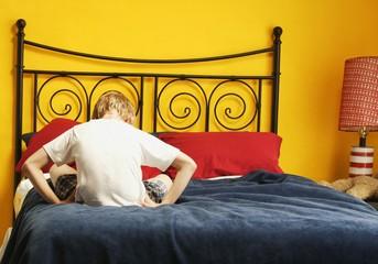 Child Sulks On Bed