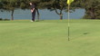 Male golfer missing the hole during competition