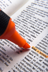 Orange marker and word drink in Spanish dictionary