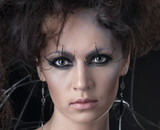 Portrait of a young brunette in a dark bizarre makeup poster