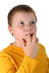 10 year old boy tasting his own finger isolated on white
