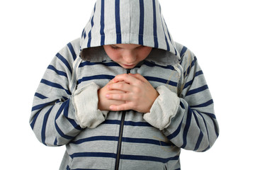 Small boy praying before the sports match isolated on white