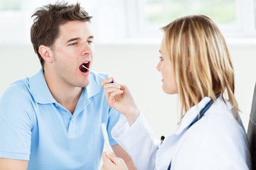 Caucasian female doctor taking a saliva sample