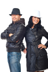 Fashionable couple in leather coats and hats