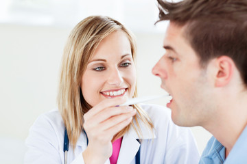Portrait of a female doctor taking a saliva sample of a patient