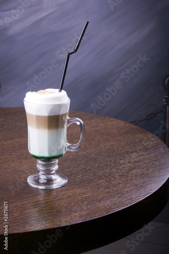 iced coffee with ice-cream topping on brown table