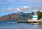 HDR view of a lighthouse with a hillside background in Dili