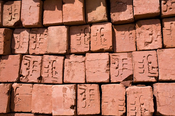 red bricks with arabic symbols