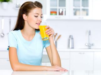 woman drinks of fresh orange juice
