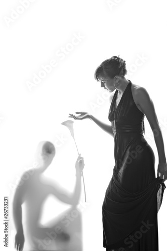 Beautiful woman and her lover shadow isolated on white